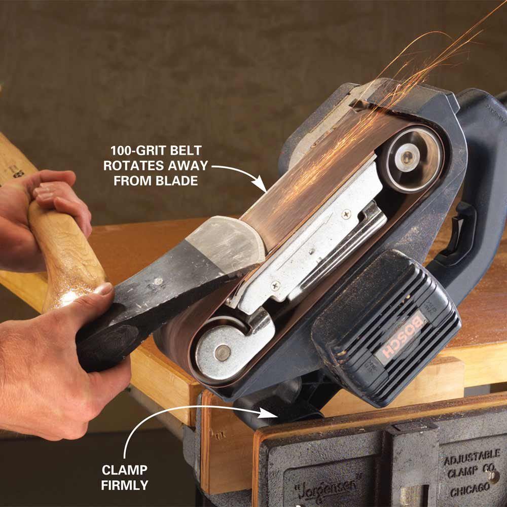 Sharpen an axe on a belt sander