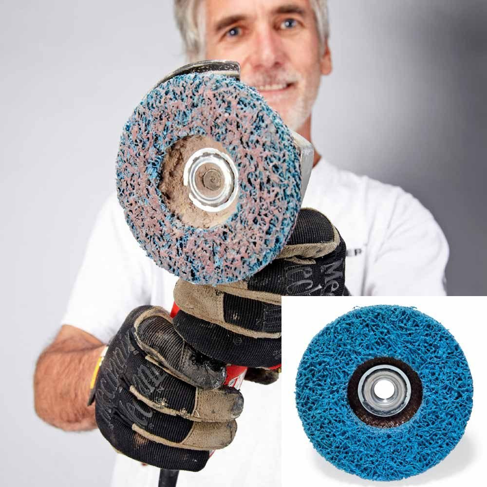 Man holding a Norton Rapid Paint Removal Wheel | Construction Pro Tips