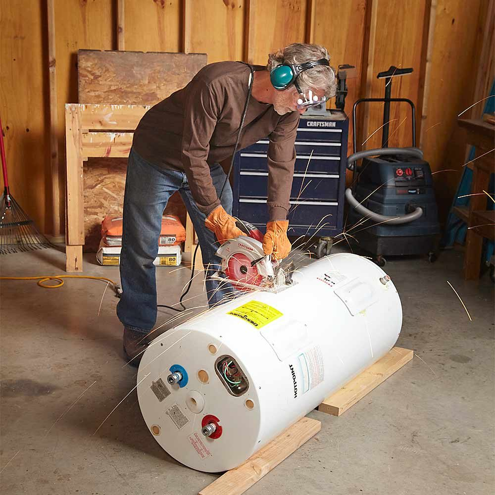 Cutting a metal water heater in half | Construction Pro Tips