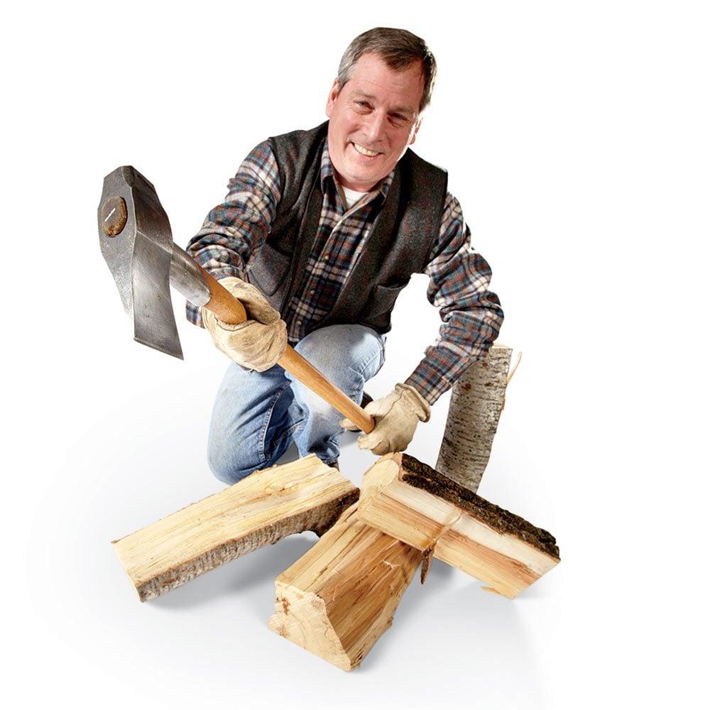 Man holding a hatchet over split wood | Construction Pro Tips