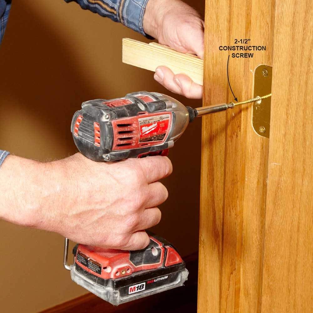 Installing long screws in each hinge | Construction Pro Tips