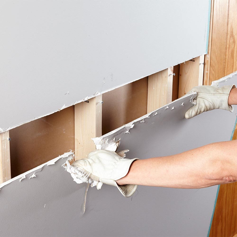 Pulling a sheet of drywall from the wall | Construction Pro Tips