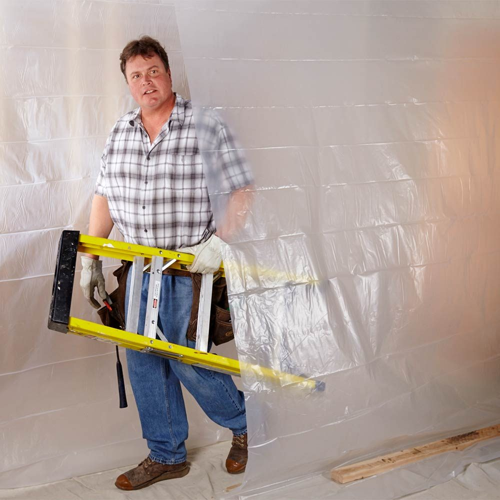 Walking through a plastic tunnel created for protection | Construction Pro Tips