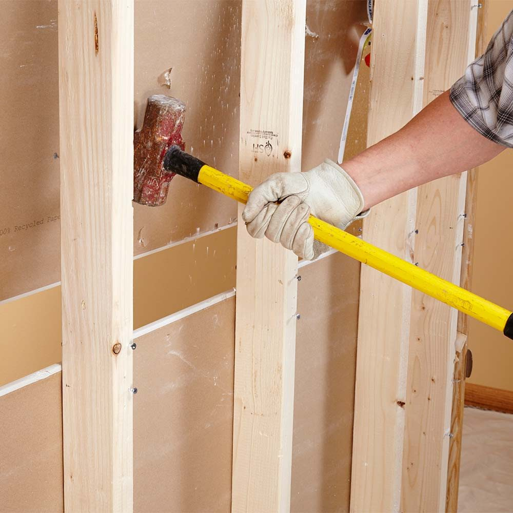 Knocking drywall out from the back side | Construction Pro Tips