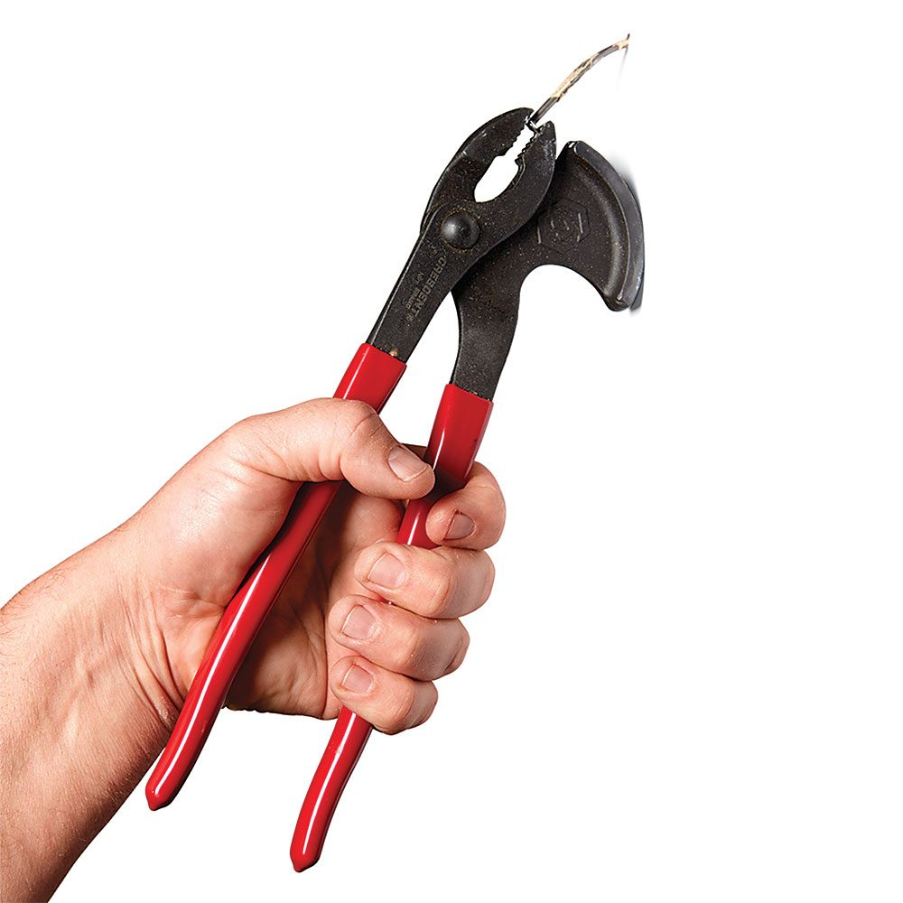Holding nails in the teeth of a pair of pliers | Construction Pro Tips