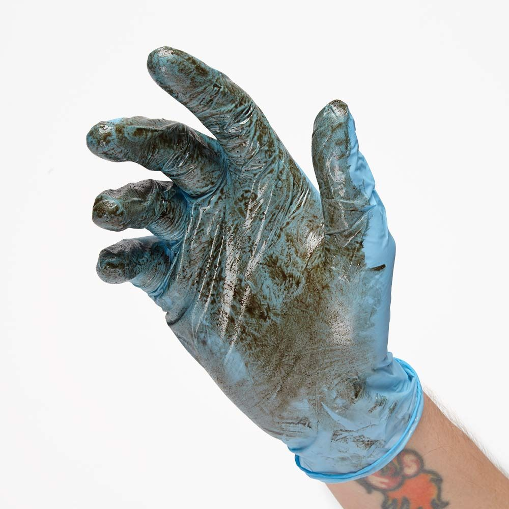 Wearing gloves to protect from dangerous distillates | Construction Pro Tips