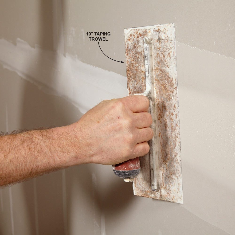 What are some good techniques for taping a drywall corner?