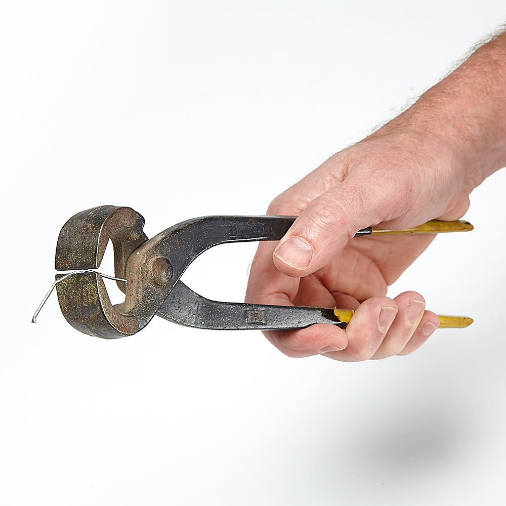 Holding brad nails in pliers | Construction Pro Tips