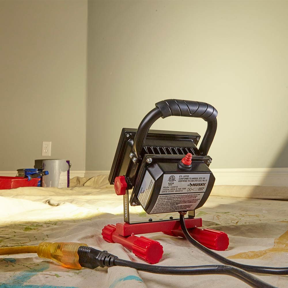 A worklight shining on a wall | Construction Pro Tips