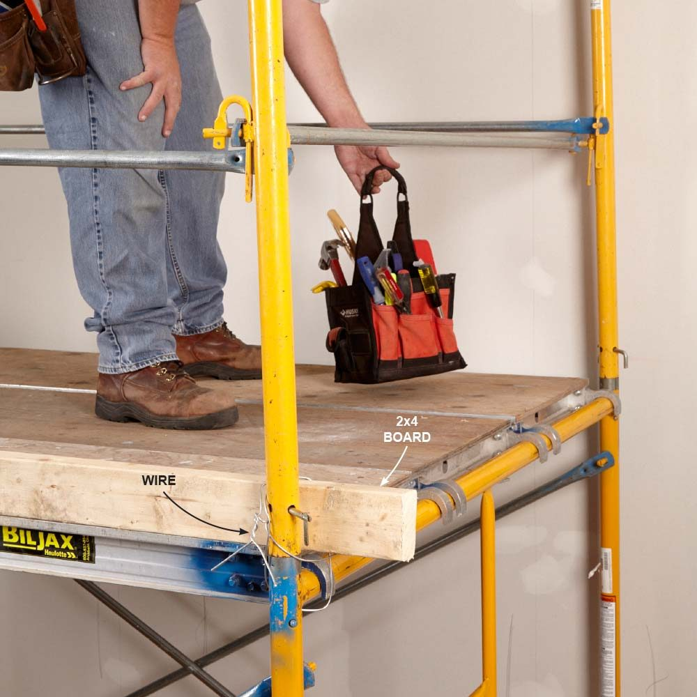 A toe board in place to prevent objects from falling off scaffolding | Construction Pro Tips