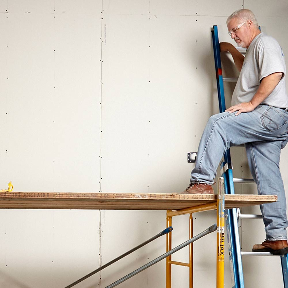 Accessing the scaffolding with a ladder on the wall | Construction Pro Tips