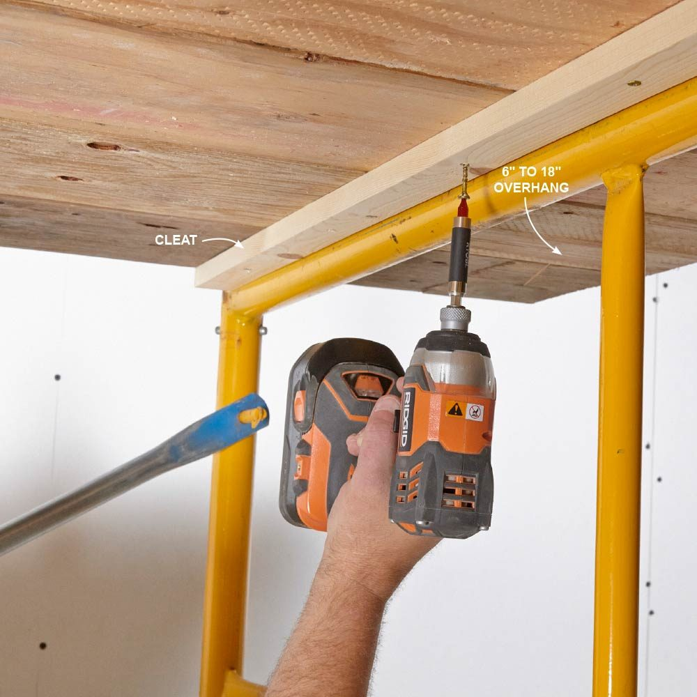Drilling through scaffolding into wooden planks | Construction Pro Tips