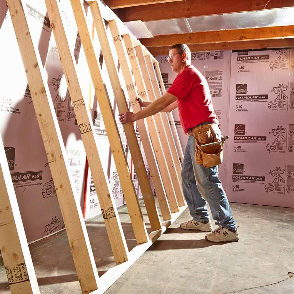 Putting pre-assembled walls in place | Construction Pro Tips