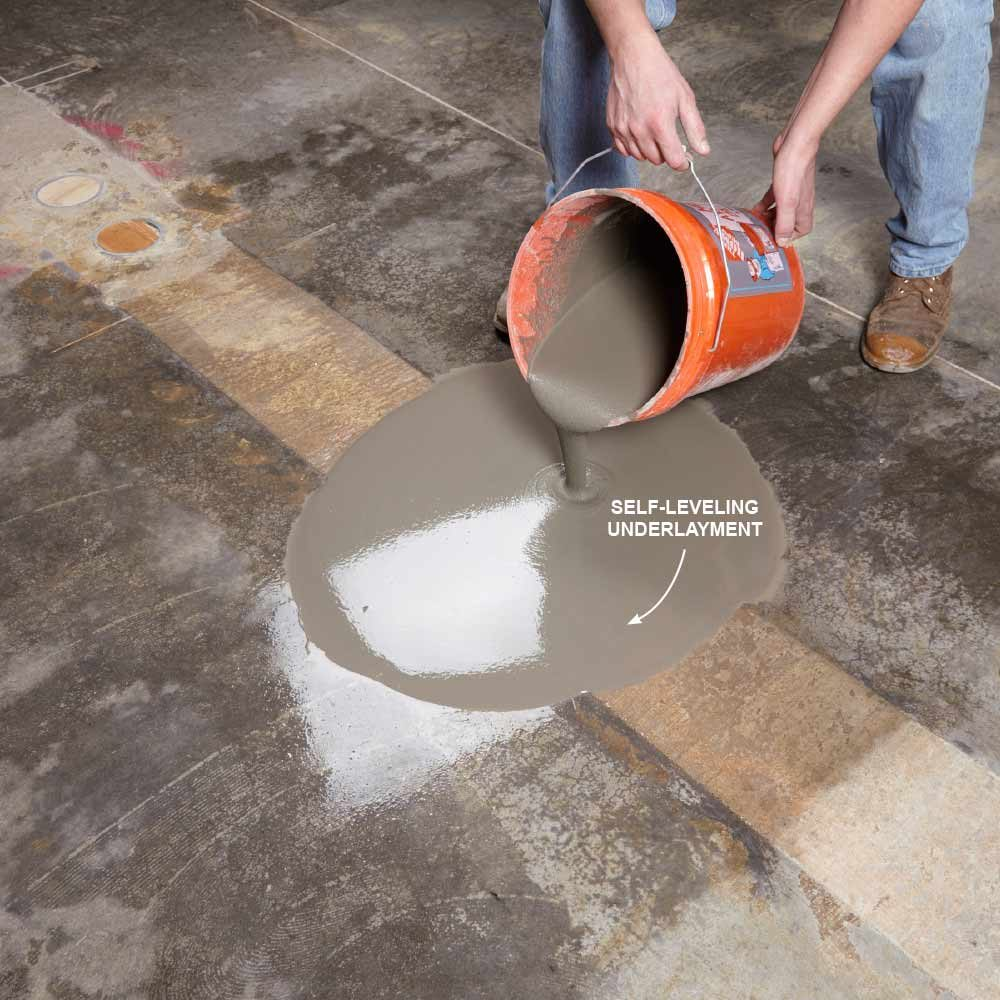 Pouring self-leveling underlayment onto the floor | Construction Pro Tips
