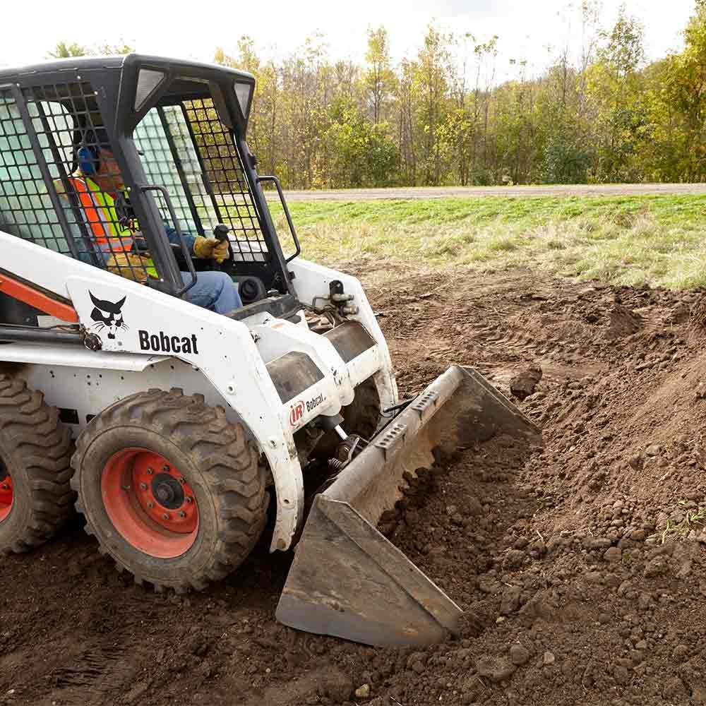 Fill a Skid Steer Bucket Before Tipping it Back