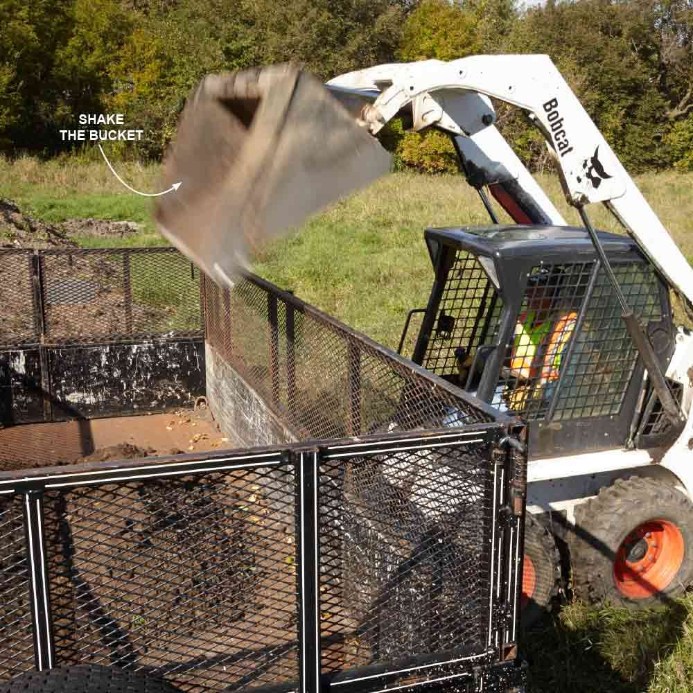 Shake a skid steer bucket