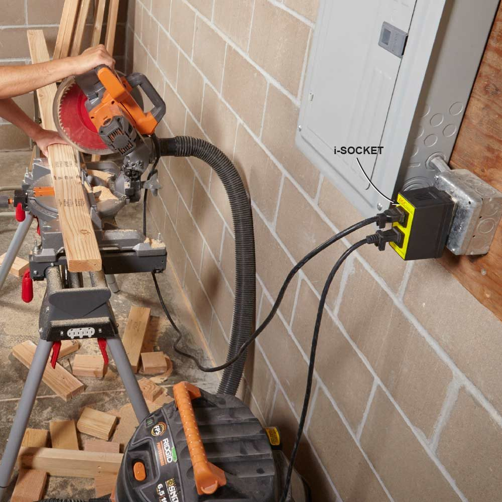 A vacuum plugged directly into a miter saw | Construction Pro Tips