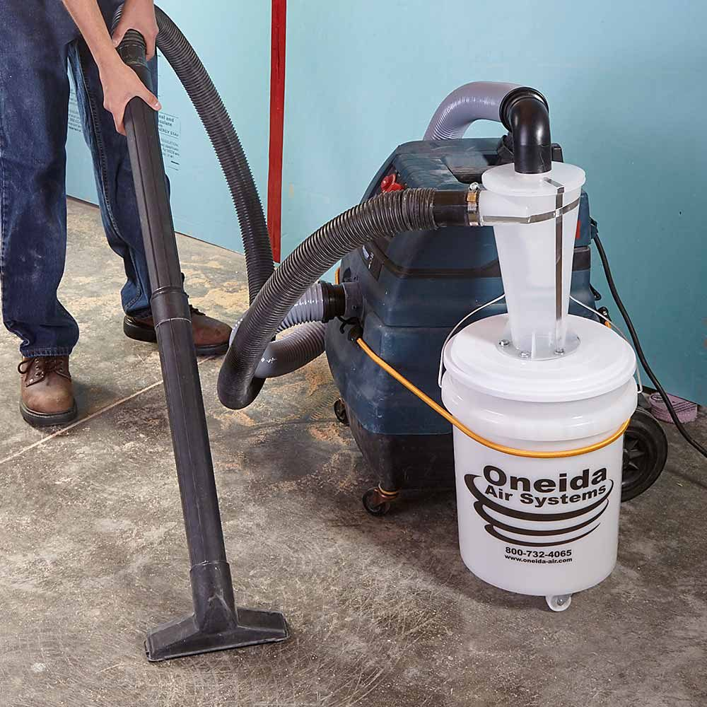 An air and debris filtration system hooked up to a vacuum cleaner | Construction Pro Tips