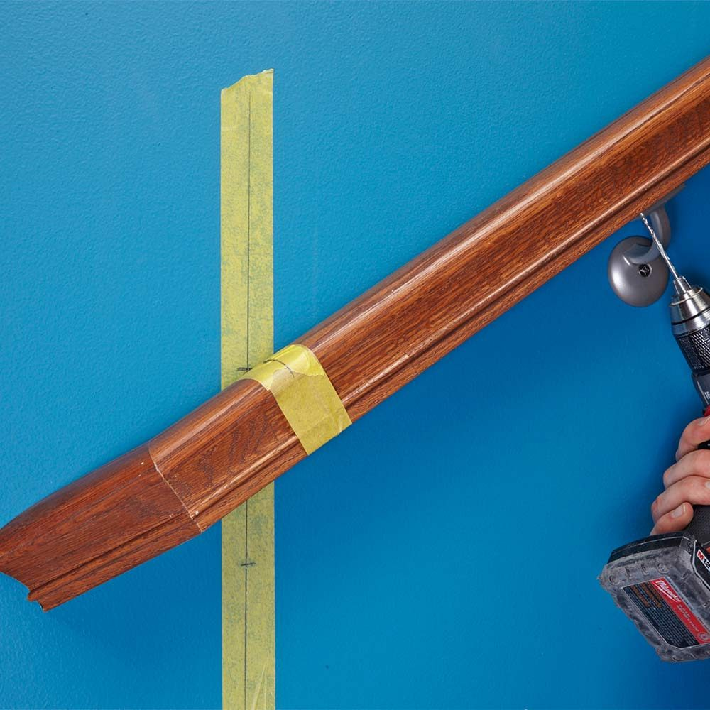 Using tape to align a hand rail | Construction Pro Tips