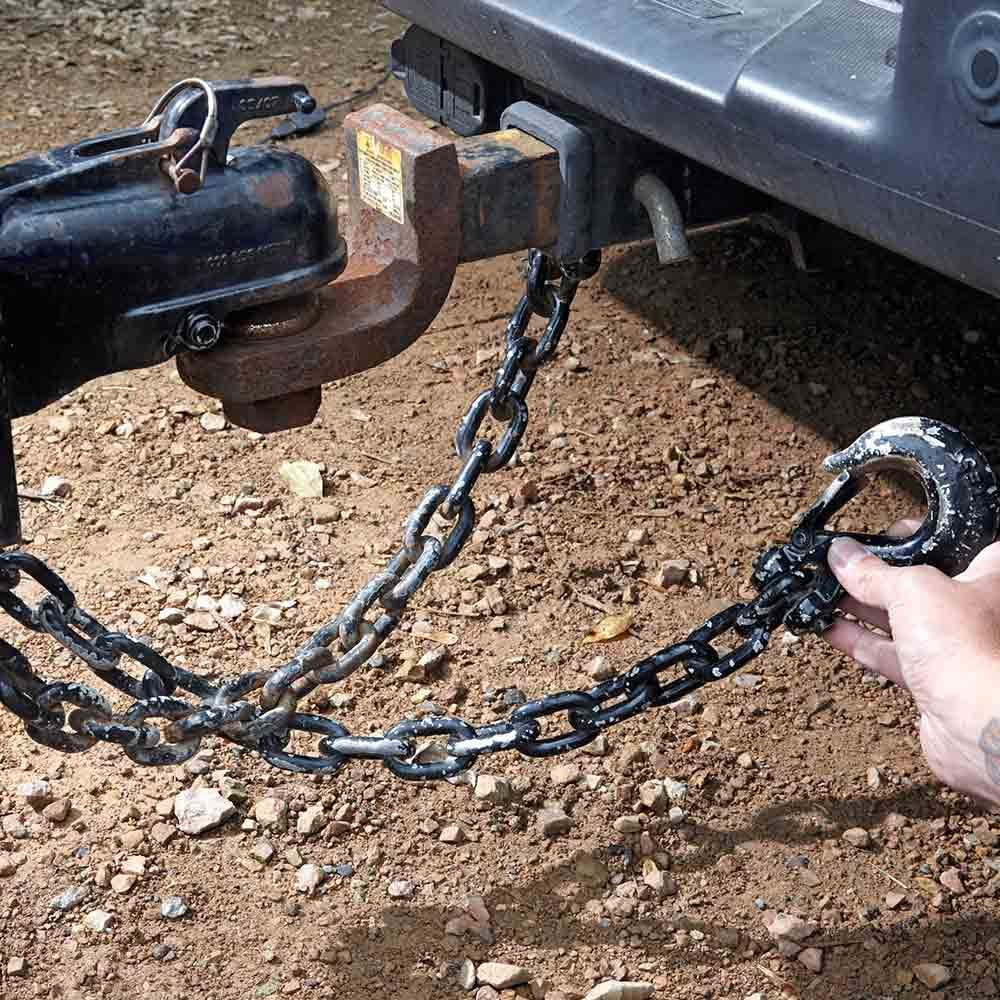Holding a hook next to a trailer hitch | Construction Pro Tips