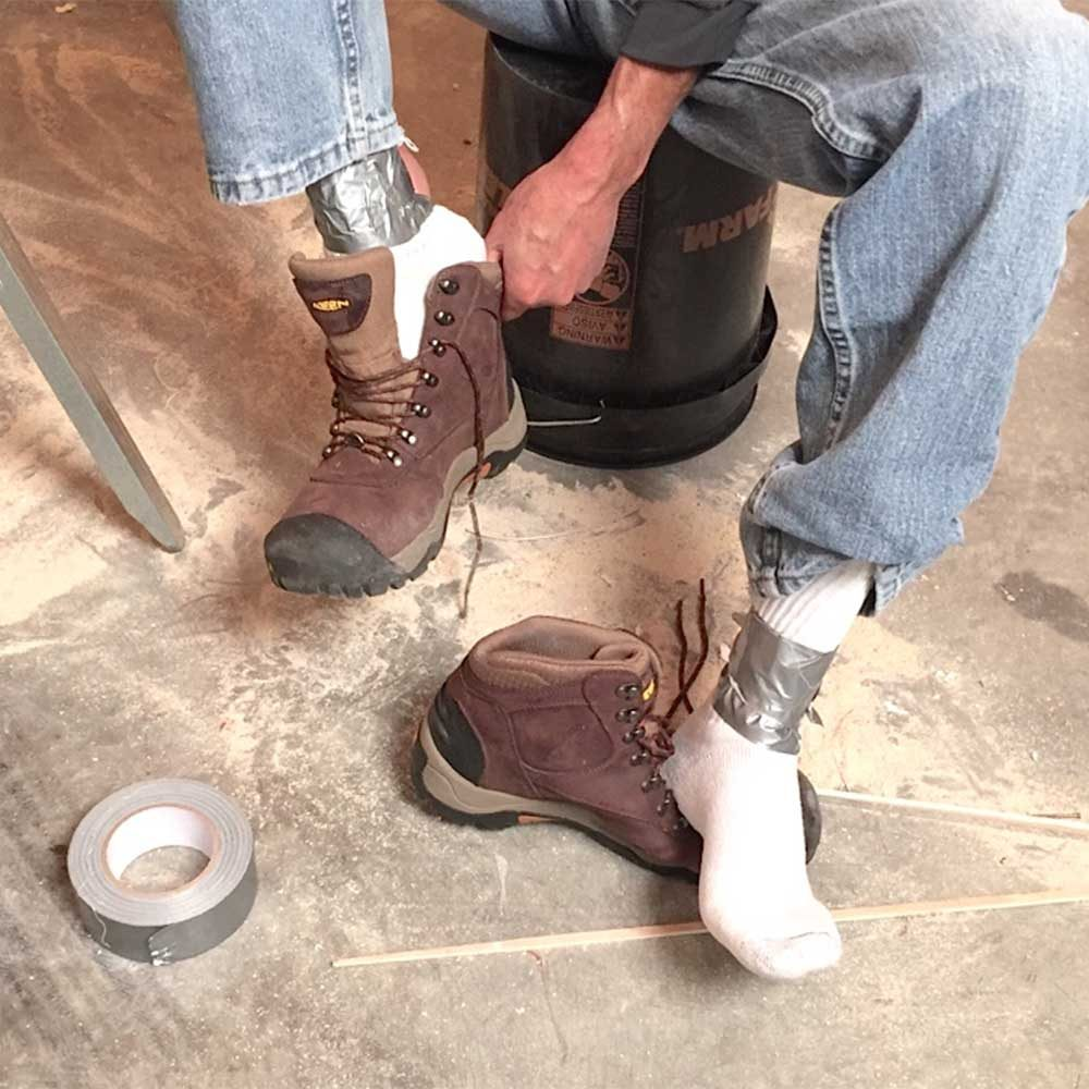 Duct tape around sock ankles to prevent chafing | Construction Pro Tips