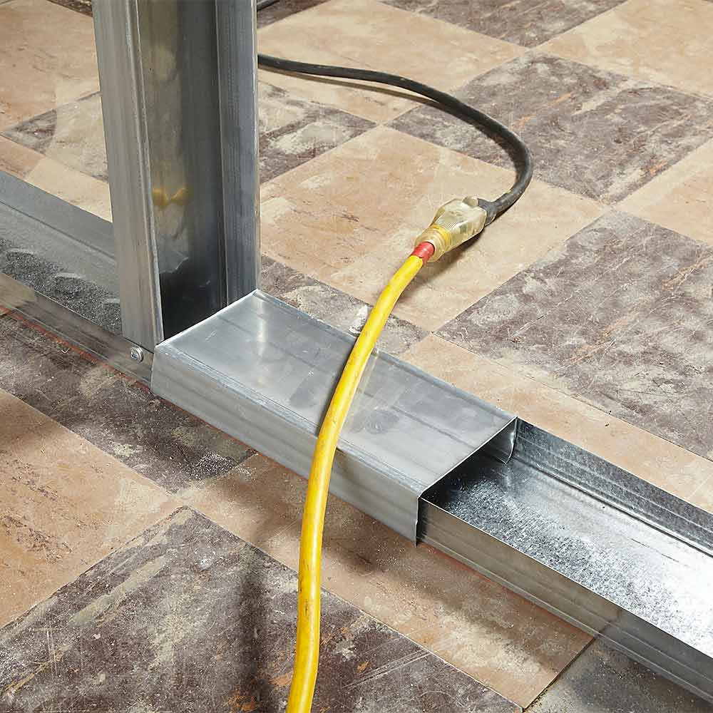 Cover that protects extension cords from being chopped | Construction Pro Tips