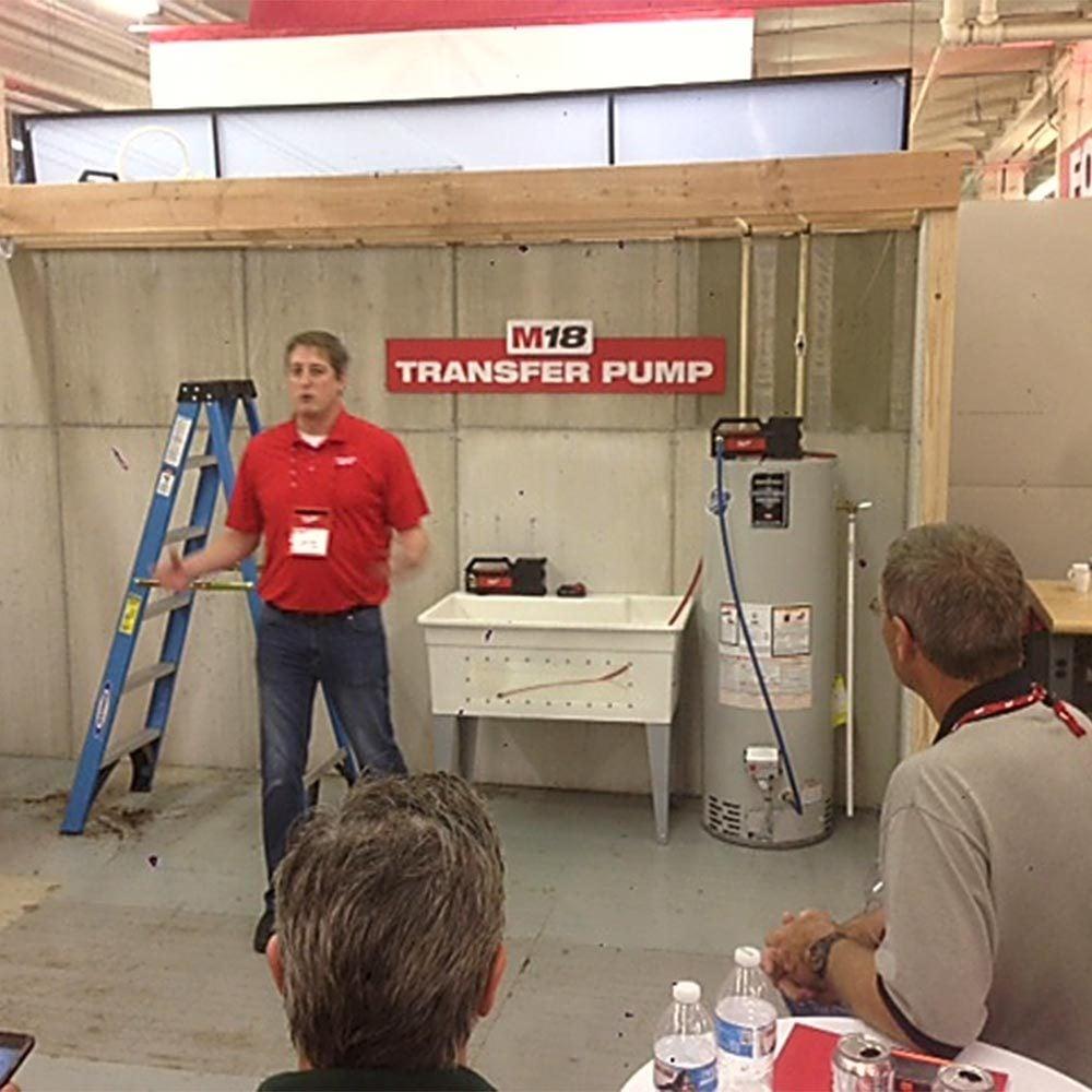 Man demonstrating Milwaukee Transfer Pump | Construction Pro Tips