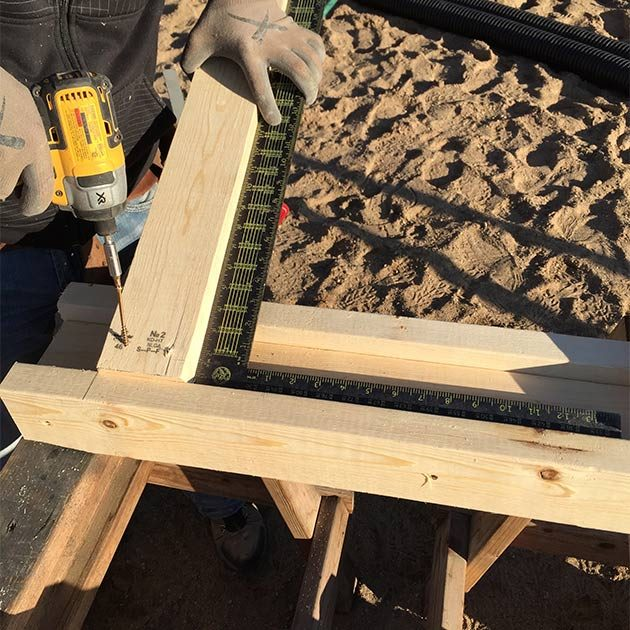 Screwing the legs to the saw horse frame | Construction Pro Tips