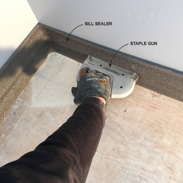 Installing sill sealer at the walls | Construction Pro Tips