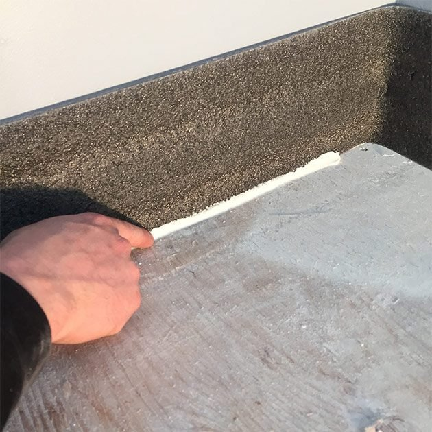 Caulk the sill sealer at the floor line along the walls | Construction Pro Tips