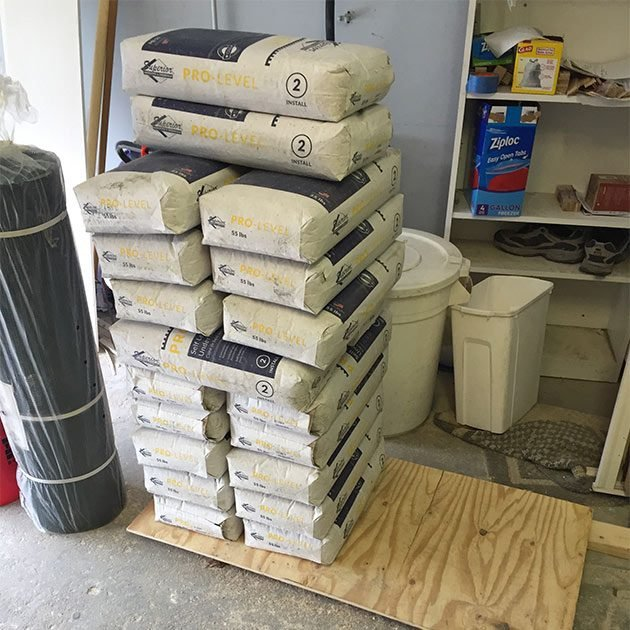A stack of bagged self-leveler | Construction Pro Tips