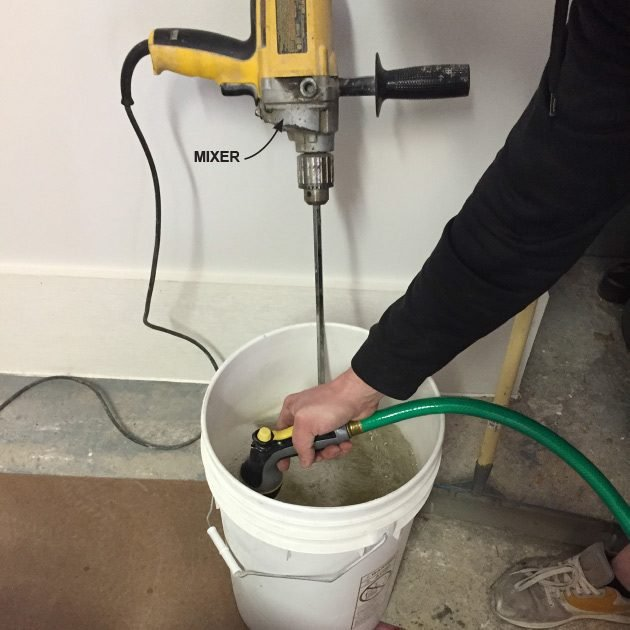 Filling the mixer bucket with a hose | Construction Pro Tips