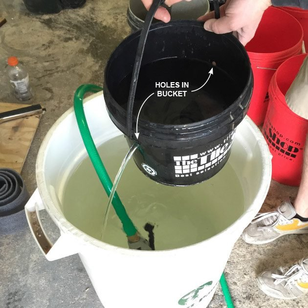 A bucket with two holes in it | Construction Pro Tips