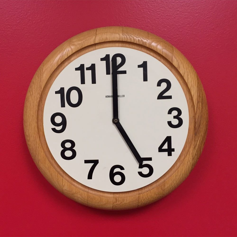 A clock on a red wall | Construction Pro Tips