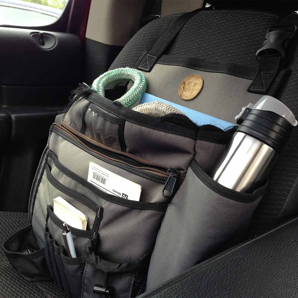 A 'Cab Commander' bag strapped to the passenger seat of a truck | Construction Pro TIps