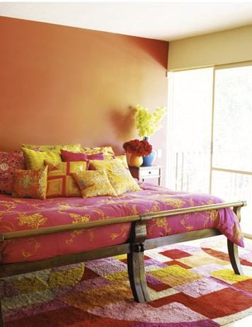 Repeated jewel tones and Asian floral designs in the bed ...
