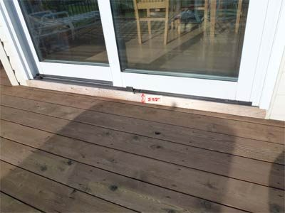 Decking installed below doorsill to prevent rot