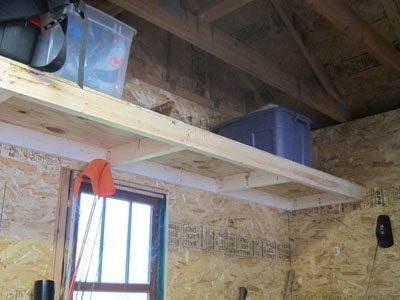 Garage storage: High shelving built with strand board and 2x4s