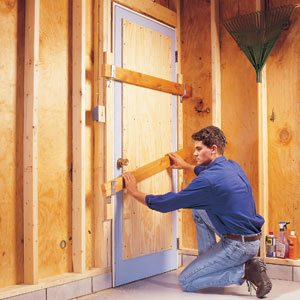 Securing a garage service door