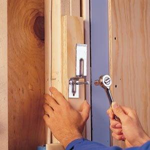Attaching the brackets to bar a door