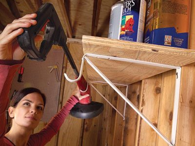 Use shelf brackets to hold tools and cords