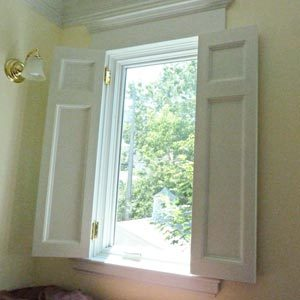 Install shutters on south-facing windows