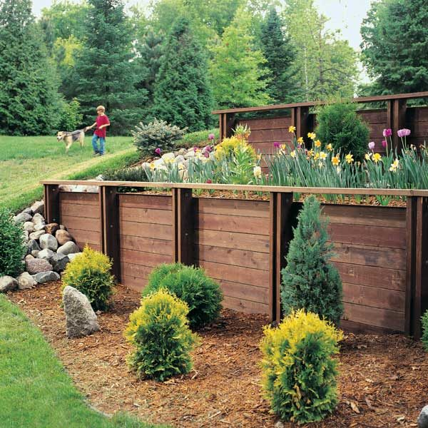 How to build a treated wood retaining wall the family for Best ways to save money when building a house