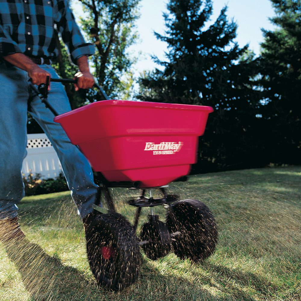 How To Use A Fertilizer And Seed Spreader The Family