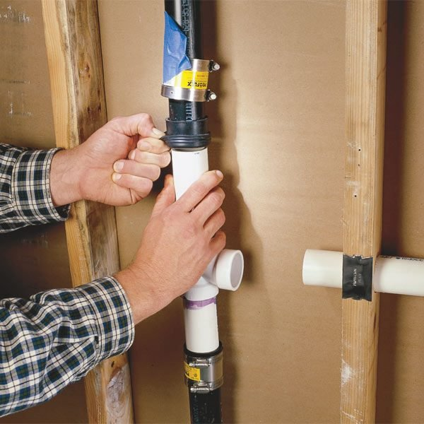 How To Connect A Pvc Pipe To Abs Pipe The Family Handyman
