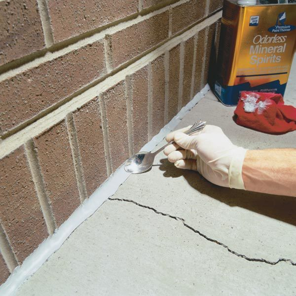 Seal cracks in concrete with durable urethane caulk. Itll keep water ...