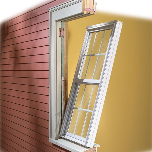 How to install vinyl replacement windows the family handyman for Picture window replacement