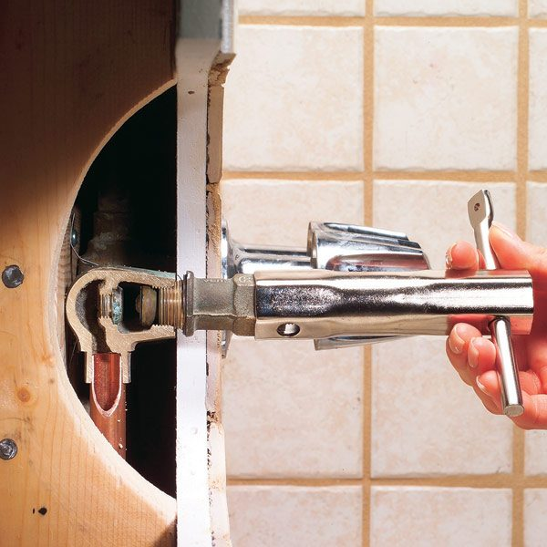 How to repair a leaking tub faucet the family handyman for How much to refurbish a bathroom