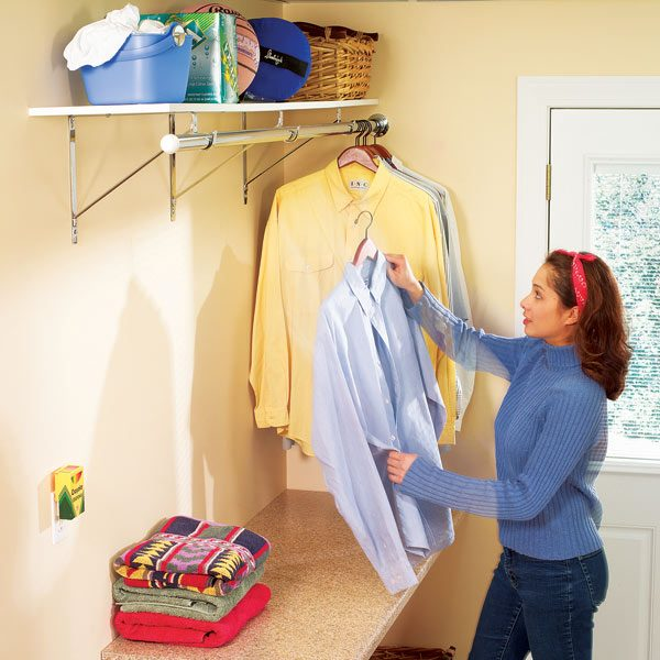 How to organize a laundry room the family handyman - Hanging rack for laundry room ...