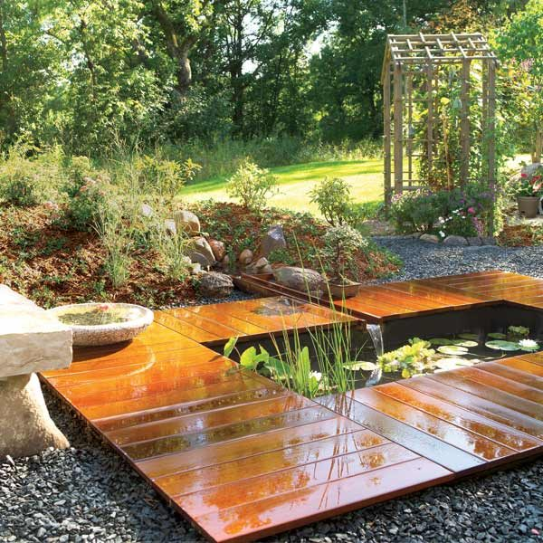 How to build a garden pond and deck the family handyman for Diy garden pool
